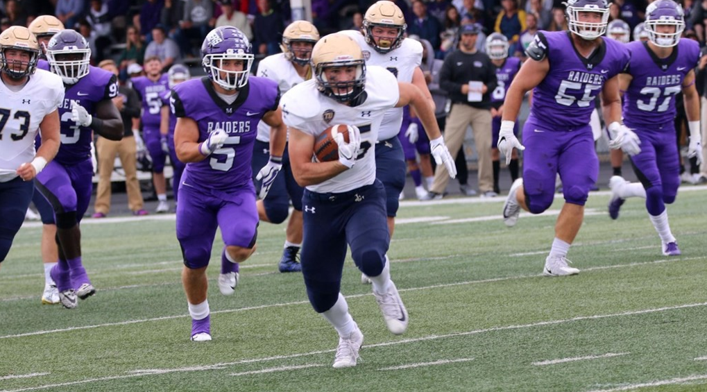 Sophomore running back Mike Canganelli rushes past the Mount Union defense on Sept. 23.