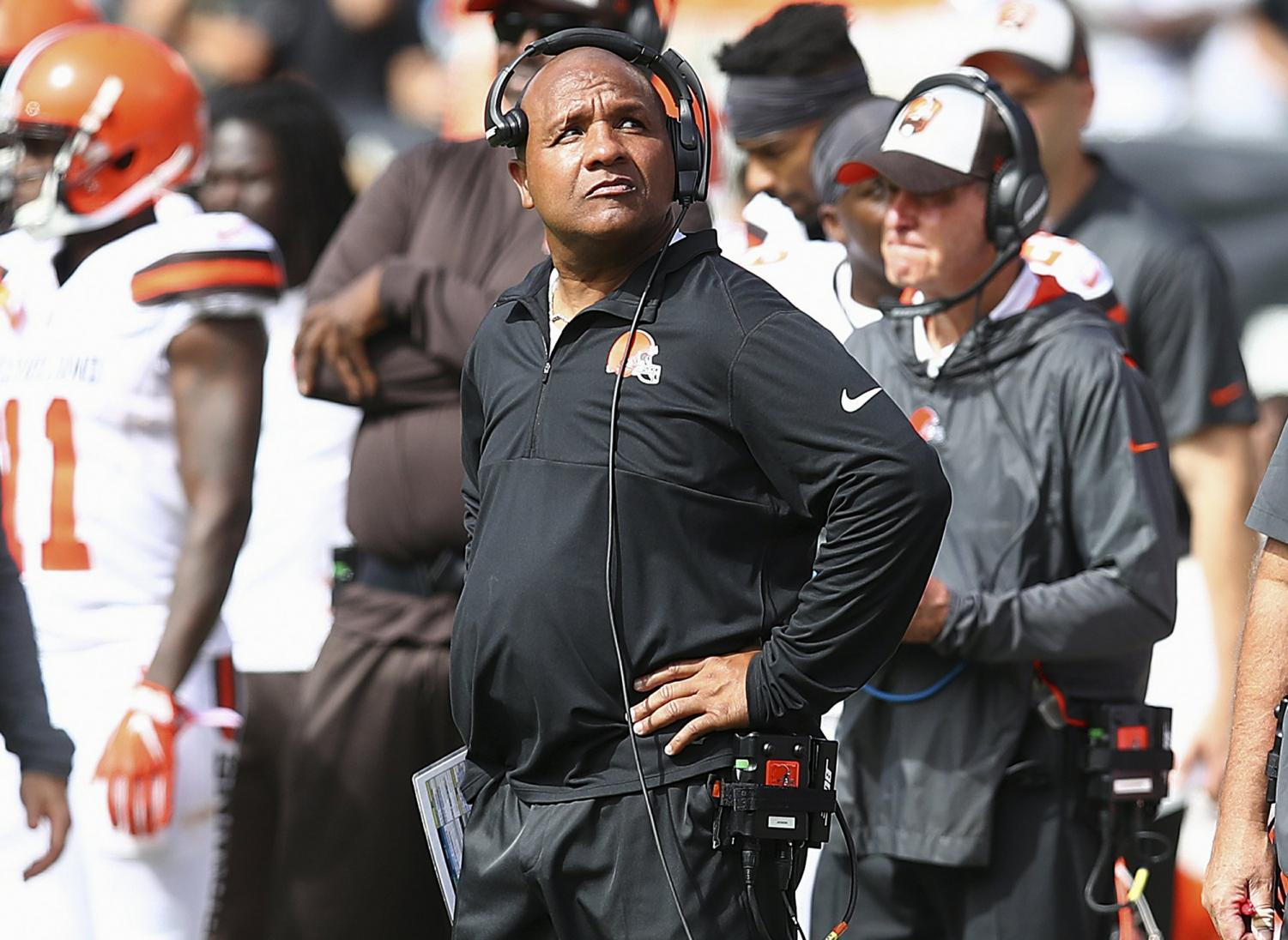 Cleveland Browns head coach Hue Jackson watches from the sideline during the first half of an NFL football game against the Oakland Raiders in Oakland, Calif., Sunday, Sept. 30, 2018.