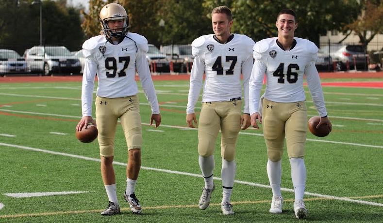 Bryce Quinlan '21 (left), Matt Danko '19 (middle), and Danny Markino '18 (right) walk the field pregame at Otterbein University
