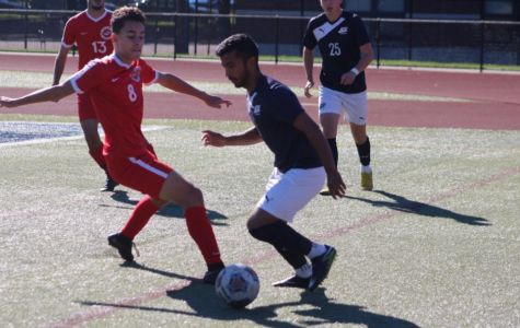 Senior Chad Kanakkanatt cuts to his left around a Muskingum defender, eyeing for his second assist on Sept. 29. JCU's Kanakkanatt had a goal & two assists.