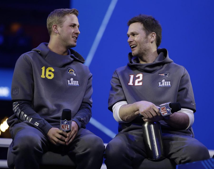 Los Angeles Rams QB Jared Goff (right) and New England Patriots QB Tom Brady (right) speak with each other at Super Bowl Media Day on Monday, Jan. 28, 2019. (Associated Press)