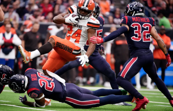 """""""Cleveland Browns running back Nick Chubb (24) is ipended by Houston Texans strong safety Justin Reid (20) in a game on Sunday, Dec. 2, 2018, in Houston."""" Photo from Associated Press, (AP Photo/Eric Christian Smith)"""
