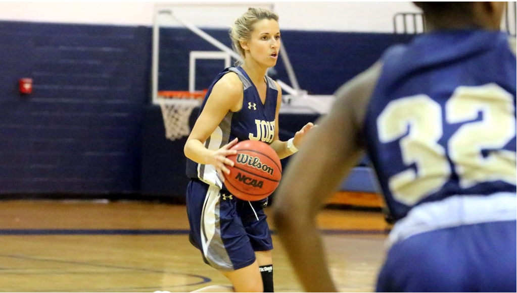 Senior point guard Kahrin Spear handles the basketball in a game for the Blue Streaks. Spear is averaging career-high 7.5 points per game and 4.0 assists. (JCU Sports Info photo)