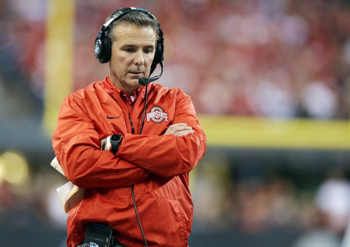 Ohio+State+football+head+coach+Urban+Meyer+crosses+his+arms+in+a+game+for+the+Buckeyes.+He+is+retiring+after+the+Rose+Bowl.+%28Associated+Press%29