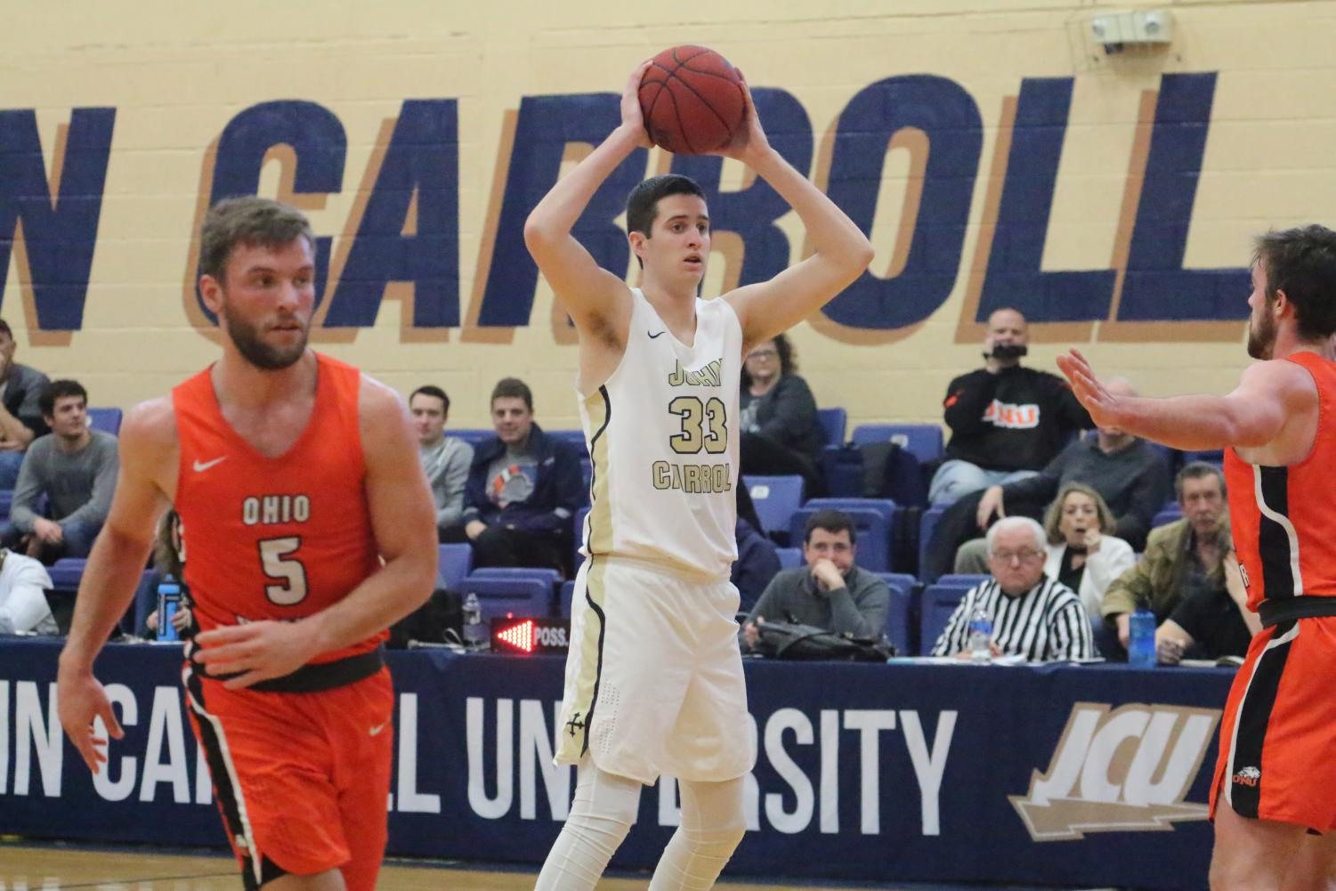 Freshman Emmett Chambers (33) looks to make a pass in a game against Ohio Northern on Feb. 9 at JCU.