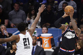 CORRECTS TO THE LAKERS, NOT THE CAVALIERS - Team LeBron's LeBron James, of the Los Angeles Lakers, shoots over Team Giannis' Joel Embiid, of the Philadelphia 76ers, during the second half of an NBA All-Star basketball game, Sunday, Feb. 17, 2019, in Charlotte, N.C. (AP Photo/Gerry Broome)
