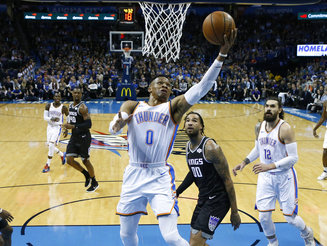 2b54b4e0c5d3 Oklahoma City Thunder guard Russell Westbrook (0) shoots in front of  Sacramento Kings center Willie Cauley-Stein (00) during the first half of  an NBA ...