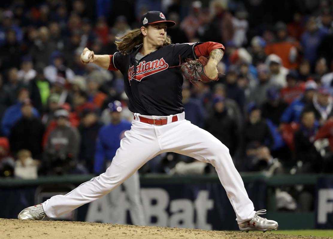 Cleveland Indians starting pitcher Mike Clevinger throws against the Chicago Cubs during the ninth inning of Game 2 of the Major League Baseball World Series Wednesday, Oct. 26, 2016, in Cleveland. (AP Photo/Matt Slocum)