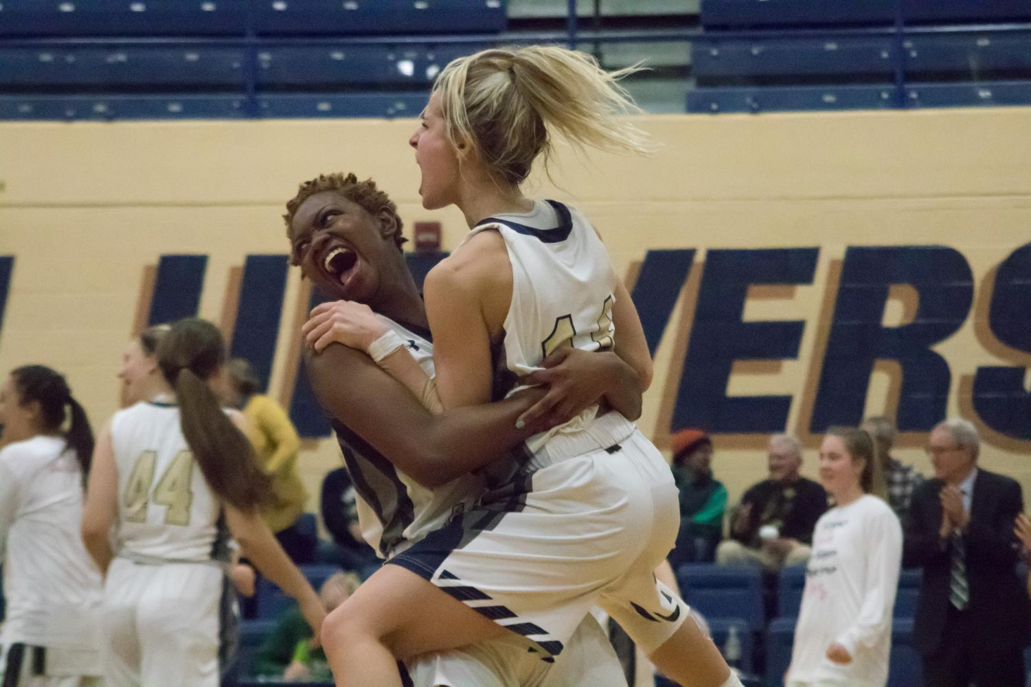 Chelbi Graham and Kahrin Spear celebrate.