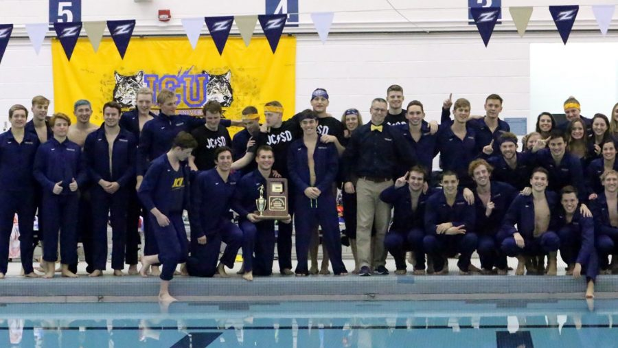 The+JCU+men%27s+swimming+and+diving+team+celebrates+after+winning+the+OAC+Championship.