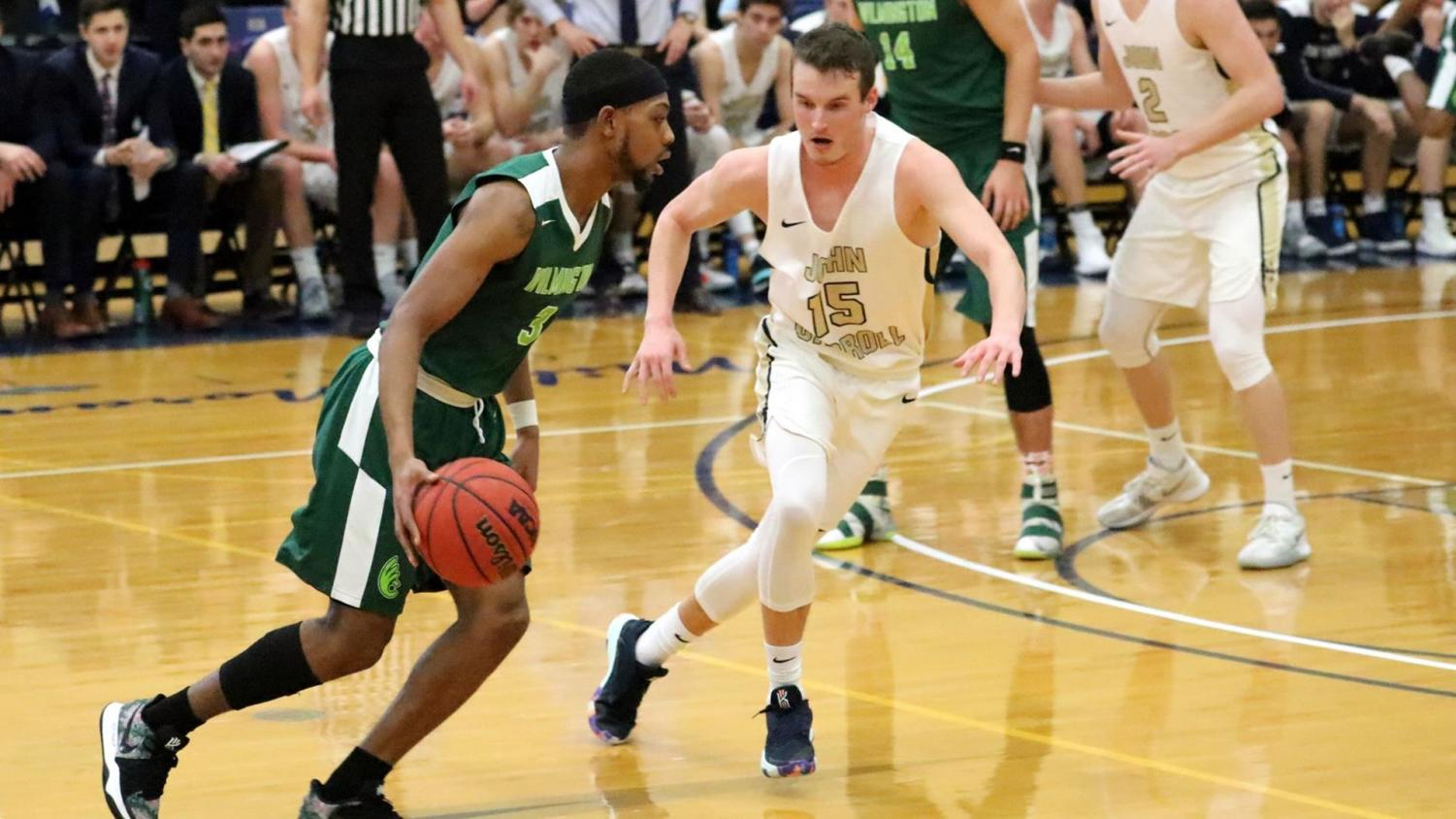 Jackson Sartain '21 guards a Wilmington player in a game on Feb. 16, 2019.