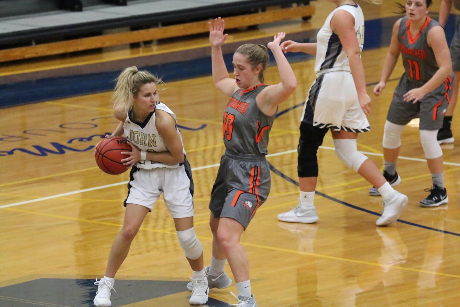 Senior point guard Kahrin Spear looks to get by an Ohio Northern defender in the final home game of the 2018 season for the Blue Streaks women.