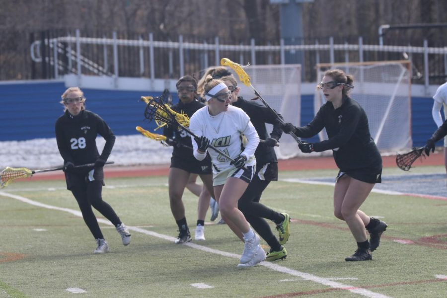 Sophomore+midfielder+Sophia+Brandimarte+looks+to+evade+a+flock+of+Wooster+defenders+in+a+game+on+Saturday+afternoon+on+March+16+at+Don+Shula+Stadium.