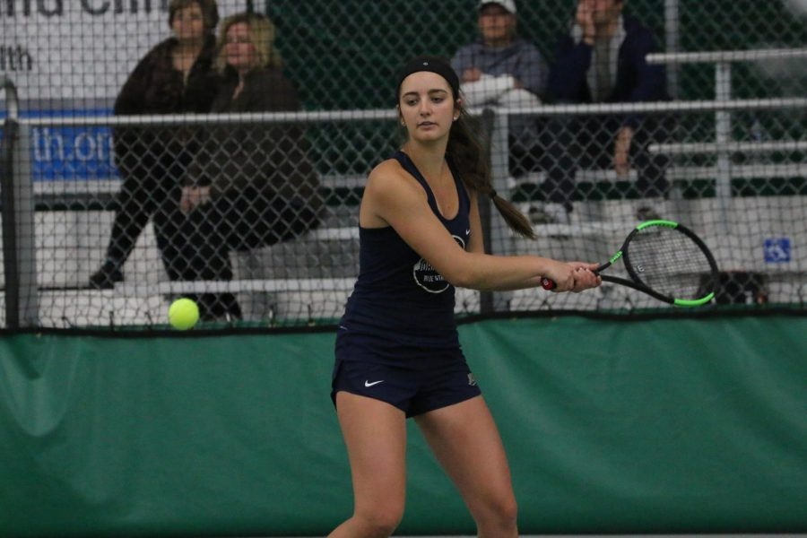 Sophomore Alyssa Krupp looks to respond to an opposition's serve in a game for the JCU women's tennis team.