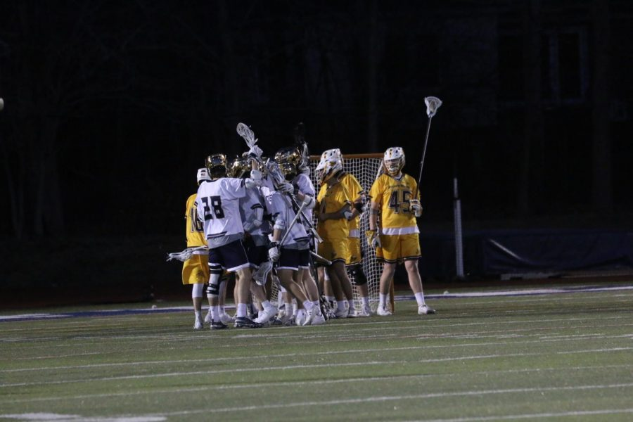 The+Blue+Streaks+celebrate+after+a+goal+in+a+game+against+Baldwin+Wallace+University+on+Wednesday%2C+April+3+at+Don+Shula+Stadium.