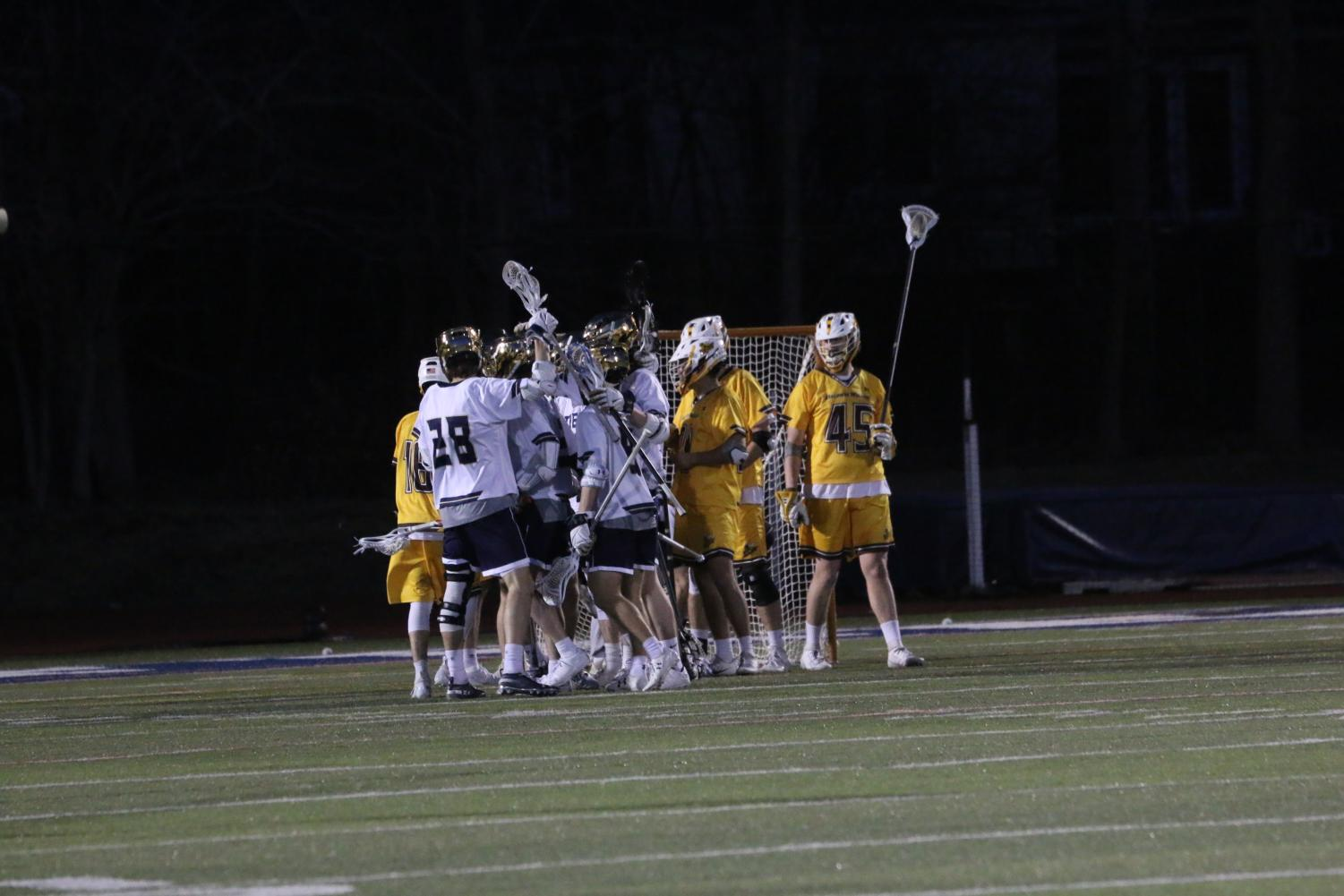 The Blue Streaks celebrate after a goal in a game against Baldwin Wallace University on Wednesday, April 3 at Don Shula Stadium.