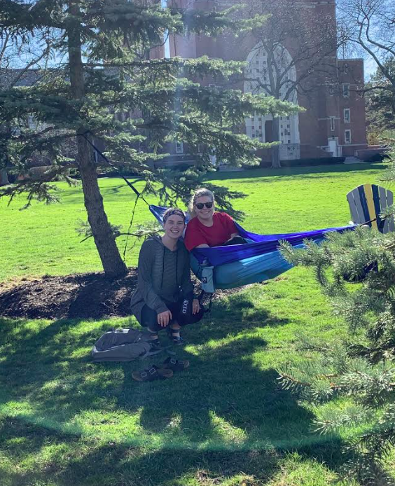 Junior Clare Tirpak and Sophomore Kendra Keane enjoying the sun and kicking it back on the Quad before heading to class.