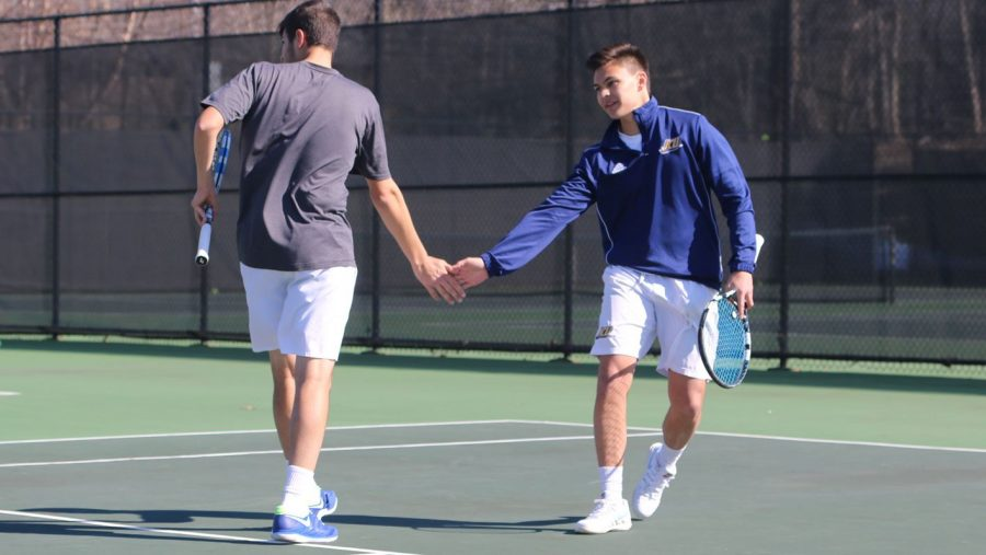 The+doubles+duo+of+senior+David+Sinese+and+sophomore+Andy+Siciliano+celebrate+after+a+win+against+Ohio+Northern.