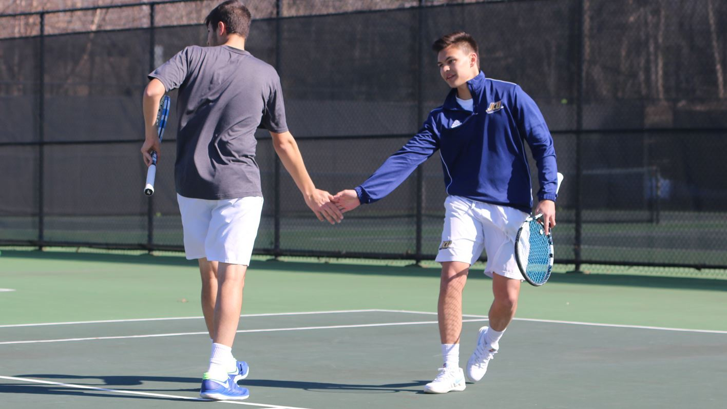 The doubles duo of senior David Sinese and sophomore Andy Siciliano celebrate after a win against Ohio Northern.