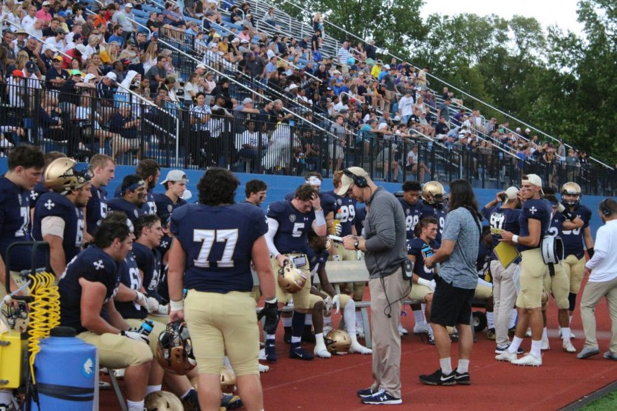 The Blue Streaks offense sits on the bench against Mount Union at Don Shula Stadium on Saturday, Sept. 28.