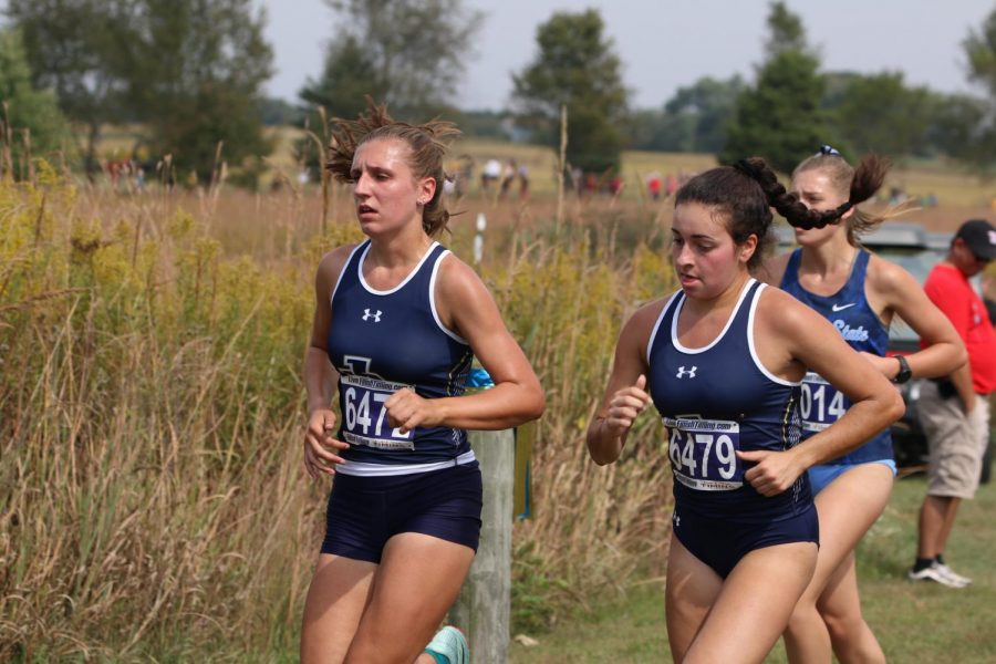 Hannah Lenze (pictured left) and Jennifer Massucci (pictured right) race at the All-Ohio Championships on Sept. 28.