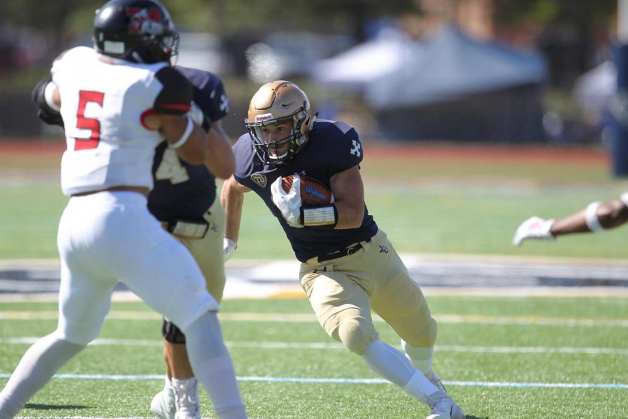 Junior+Michael+Canganelli+carries+the+ball+against+Muskingum+on+Oct.+5%2C+at+Don+Shula+Stadium.