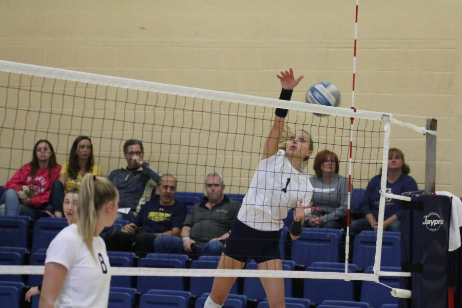 Senior Jenna Dvorsky follows through on a kill attempt (1) as Shannon Atwell (8) looks on in a game at the DeCarlo Varsity Center on Oct. 12.