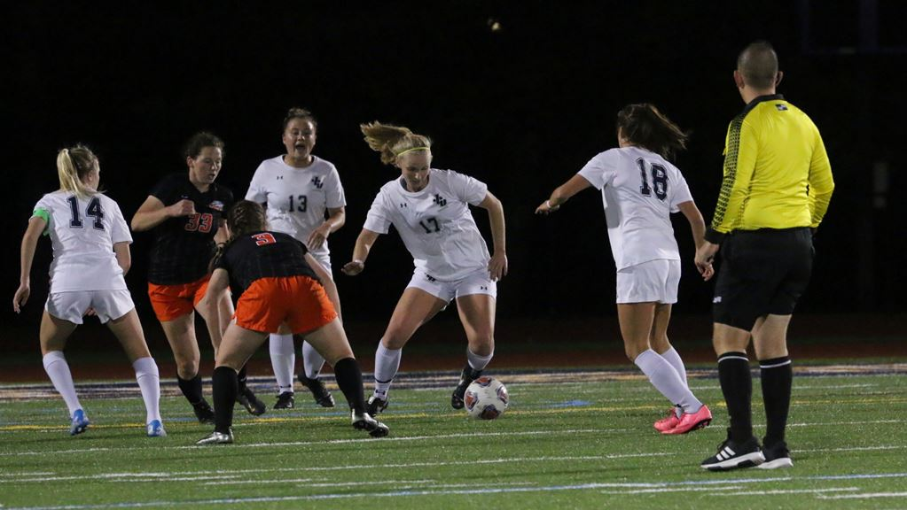 Freshman Claire Hollern (Middle, No. 17) dribbles around defenders in a game at Don Shula Stadium on Oct. 19, against Ohio Northern.