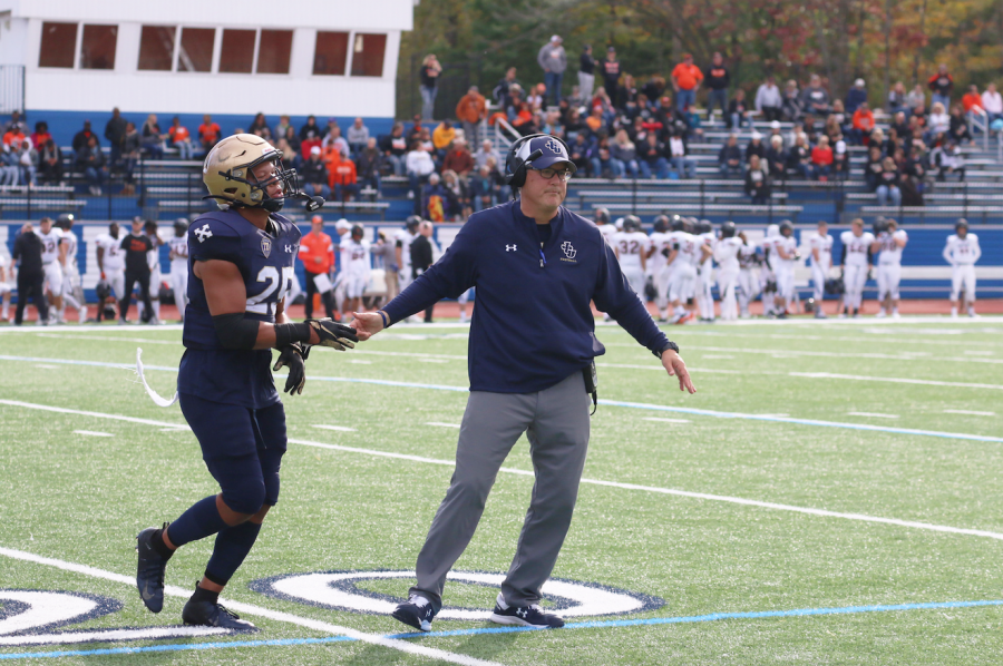 Senior defensive back Cole Griffin [right] and head coach Rick Finotti [left] high-five in a game against Ohio Northen.