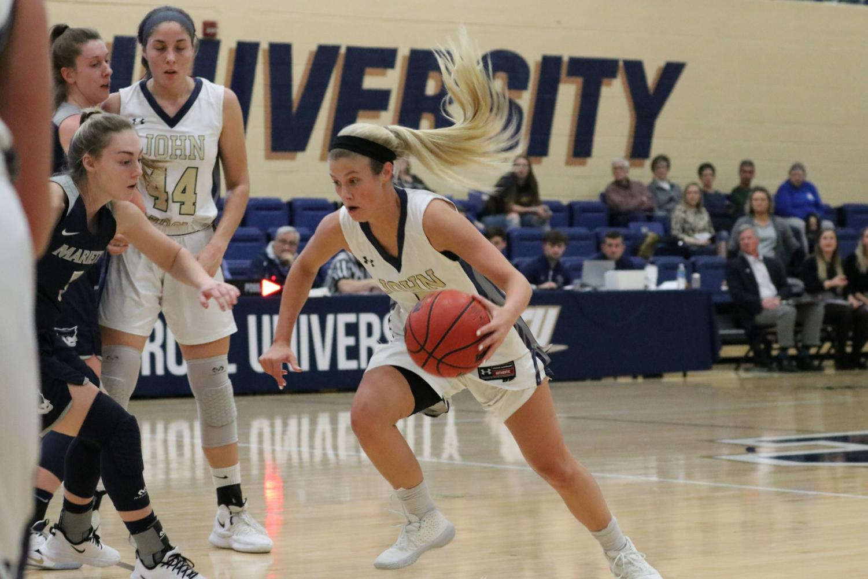 Senior Sarah Sprecher drives to the basket against Marietta at the Tony DeCarlo Varsity Center on Dec. 7, 2019.