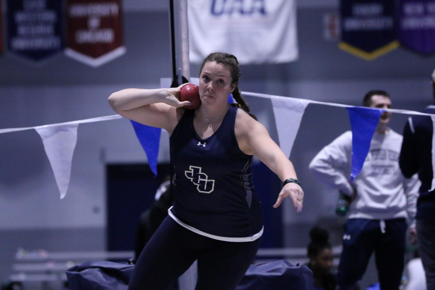 Sophomore Olivia Hurtt holds the shot put in a competition at Case Western on Saturday, Dec. 7.