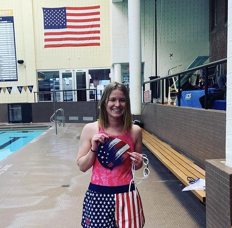 Ynyra Bohan holds a USA themed swim cap in the Johnson Nataorium after becoming a U.S. Citizen.