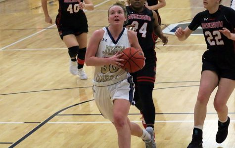 Junior Abby Adler (ball in hand) drives to the rim in a game against Muskingum at the DeCarlo Varsity Center.