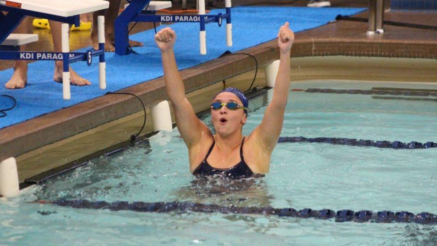 Senior Felice Ferrante celebrates a victory in her final meet at the Johnson Natatorium.