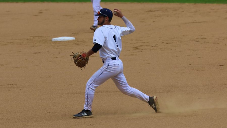 Junior Sam Heaton throws the ball in a game.