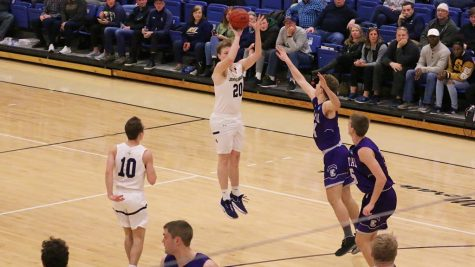 P.J. Flannery attempts a 3-pointer in the OAC Quarterfinal against Capital as his brother Sean (10) looks on.