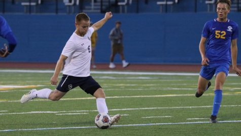 Senior Michael Adelman propels back for a kick at Don Shula Stadium.