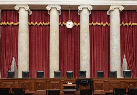 The Supreme Court bench draped for the death of Justice Ruth Bader Ginsburg  (Fred Schilling/Collection of the Supreme Court of the United States via AP)