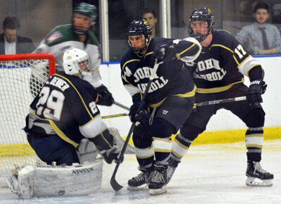 Brian Russell (far right) plays in a game for JCU Club Hockey.