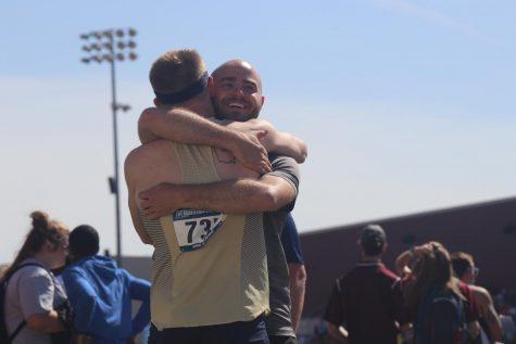 Jake Alexander hugs Hayden Snow
