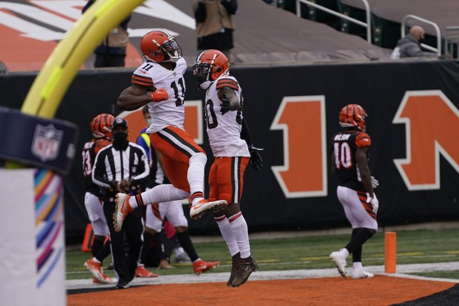 Cleveland Browns' Donovan Peoples-Jones (11) celebrates his touchdown reception with Jarvis Landry (80) during the second half of an NFL football game against the Cincinnati Bengals, Sunday, Oct. 25, 2020, in Cincinnati. (AP Photo/Bryan Woolston)