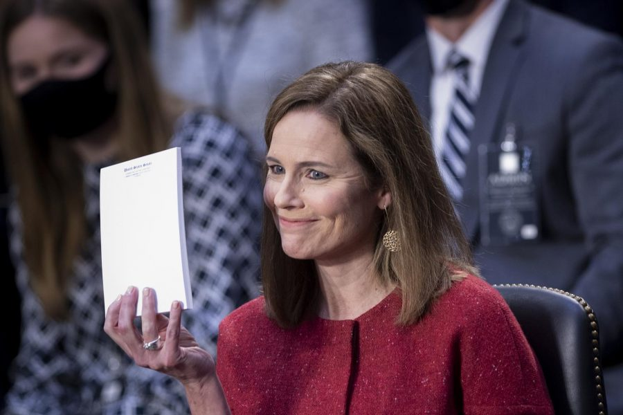 Supreme Court nominee Amy Coney Barrett holds up a notepad of paper during her confirmation hearing before the Senate Judiciary Committee on Capitol Hill in Washington, Tuesday, Oct. 13, 2020. (Brendan Smialowsi/Pool via AP)