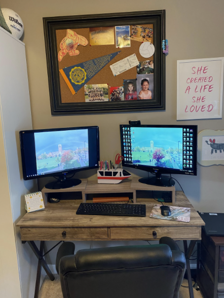 Dr. Brooke Turner's for space consists of a cork board, tiered desk and two desktop screens for an optimal viewing and teaching experience.