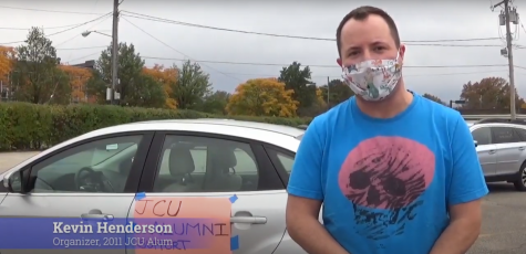Kevin Henderson, John Carroll alumnus and protest organizer, speaks to The Carroll News