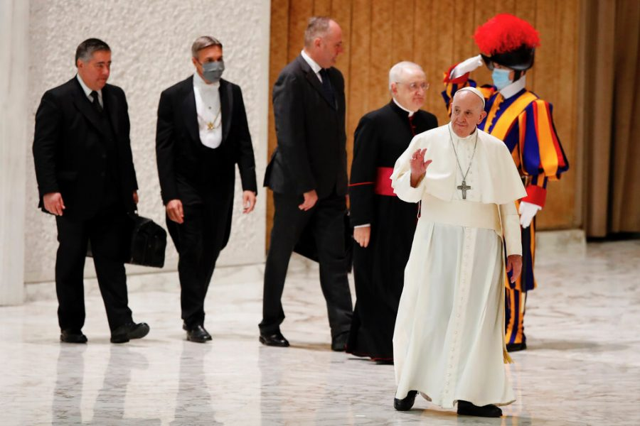 """Pope Francis arrives in the Paul VI Hall at the Vatican for his weekly general audience, Wednesday, Oct. 28, 2020. Pope Francis has blamed """"this lady COVID"""" for forcing him to keep his distance from the faithful during his general audience, which was far smaller than usual amid soaring coronavirus infections in Italy. (AP Photo/Alessandra Tarantino)"""