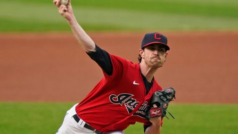 """Cleveland Indians starting pitcher Shane Bieber delivers in the first inning of a baseball game against the Chicago White Sox, Wednesday, Sept. 23, 2020, in Cleveland."" (AP Photo/Tony Dejak)"