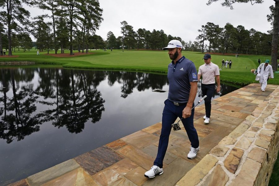 Dustin Johnson, left, walks with Rory McIlroy, of Northern Ireland, to the 15th green during a practice round for the Masters golf tournament Tuesday, Nov. 10, 2020, in Augusta, Ga. (AP Photo/Matt Slocum)