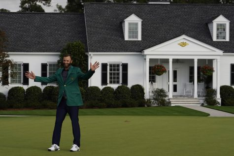 """Dustin Johnson stands in front of the Augusta National Golf Clubhouse after his victory at the Masters golf tournament Sunday, Nov. 15, 2020, in Augusta, Ga."" (AP Photo/Chris Carlson)"