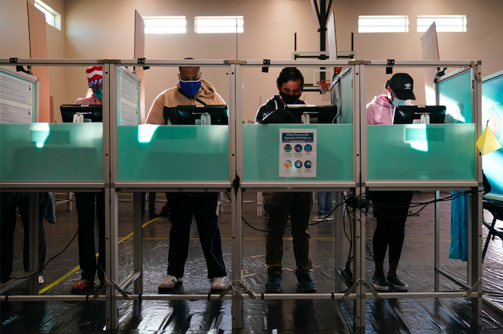 People vote at a polling place on Election Day, Tuesday, Nov. 3, 2020, in Las Vegas. (AP Photo/John Locher)