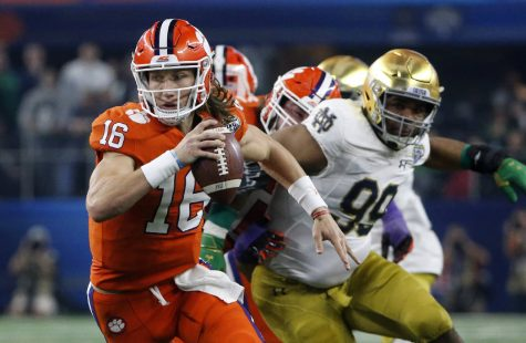 """Clemson quarterback Trevor Lawrence (16) scrambles out of the pocket during the NCAA Cotton Bowl semi-final playoff football game against Notre Dame on Saturday, Dec. 29, 2018, in Arlington, Texas."" (AP Photo/Michael Ainsworth)"
